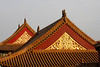 Sunlight brightens the golden artwork decorating the rooftops of the palace.