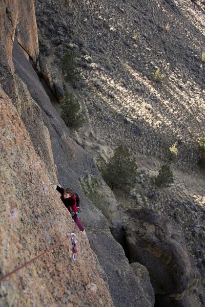 Tracy balances her way delicately up <i>Wherever I May Roam 5.9</i> at Smith Rock State Park.