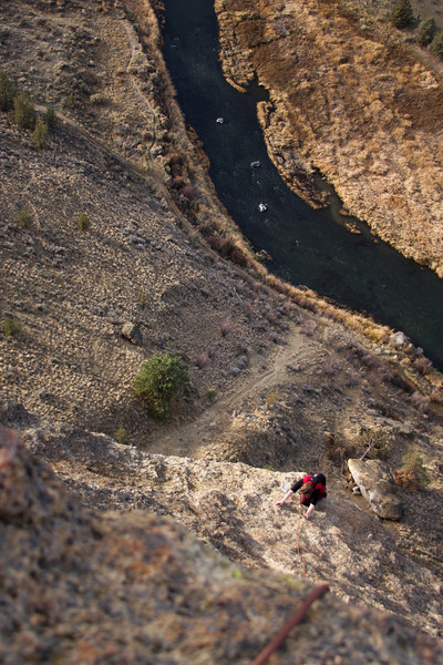 High above the Crooked River, Tracy works the fifth and last pitch of <i>Wherever I May Roam 5.9</i>.