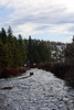 The Deschutes River flows along rather placidly, with the remnants of an old bridge still standing midstream.