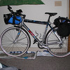 My original touring setup. One piece rear panniers, with the sleeping bag and tent up front. Tent poles along the frame.