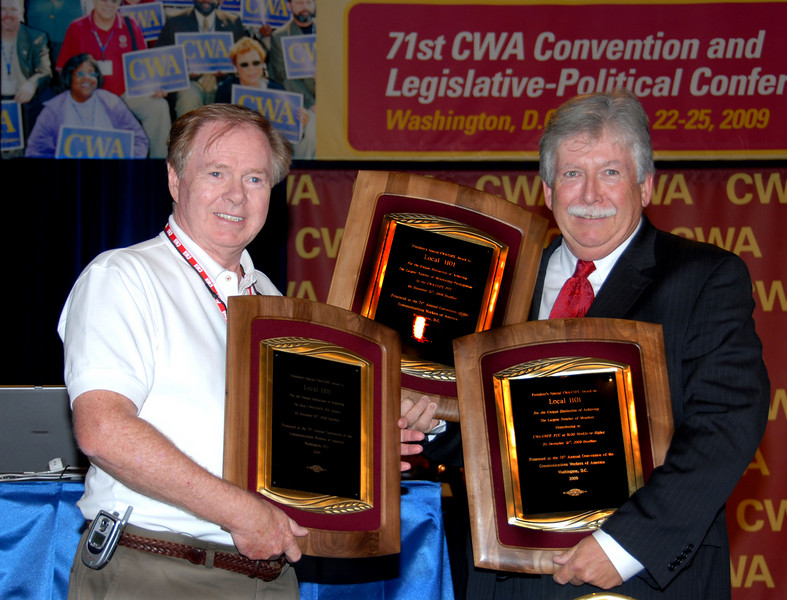 Local 1101 President Joe Connolly (left) is presented with three Cope awards by District 1 Vice President Chris Shelton.