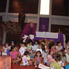 Fr. Simon, C.S.C. blessing children after Mass at St. George's College