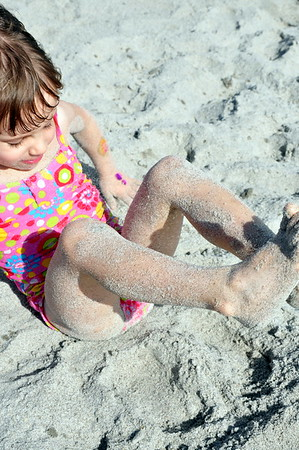Cailyn covered in sand
