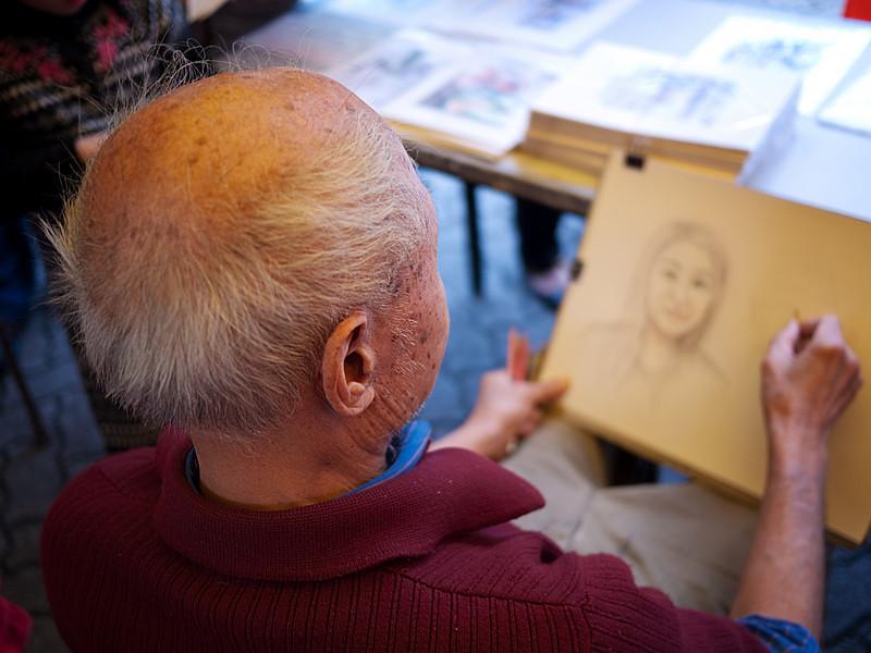 portrait artist sketching anna