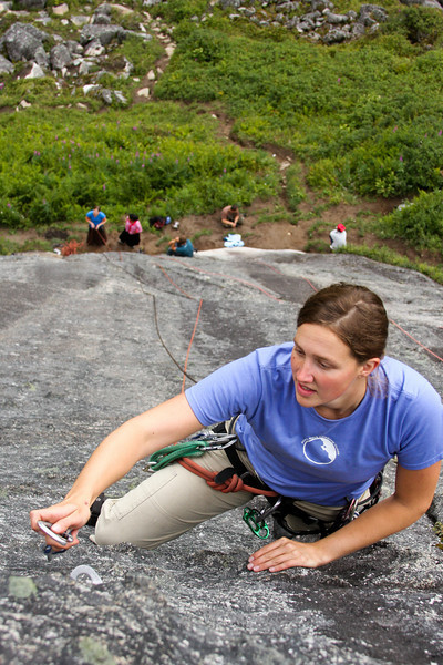 Shasta Miller pauses to make a clip on <i>Local Motion 5.7</i> with a considerable runout behind her.