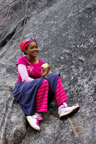 Uniqueka enjoys an afternoon snack, perched comfortably on the solid granite of Hatcher Pass.