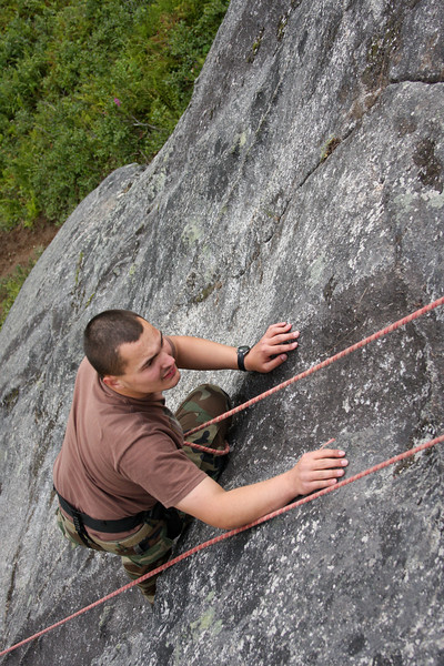 """The route's namesake """"Chickenhead"""" holds provide security for Steven as he moves through the crux."""