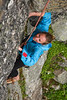 Katie Coan gives off a grin as she deciphers the moves that will bring her through this crux.