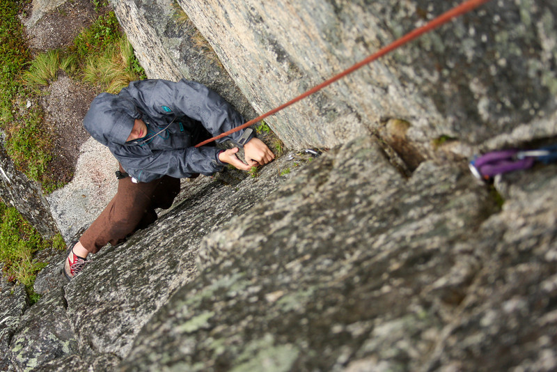 Tracy Borland climbs higher on <i>Physical Attraction 5.8</i> in a soaking Hatchers downpour.