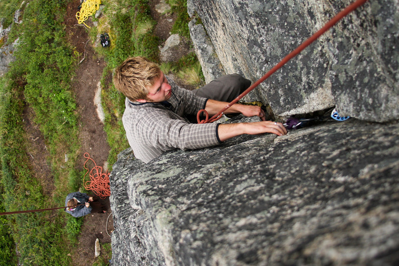 Cody climbs higher on <i>Physical Attraction 5.8</i> with Tracy at the belay.