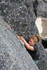 Moves go by as Melissa climbs <i>The Slot 5.7</i> on the Monolith in Archangel Valley.