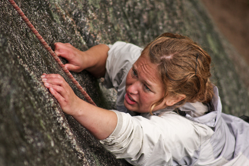 Holds are slimy and tension is high as Melissa moves up on <i>Zig Zag 5.9</i> in the rain.