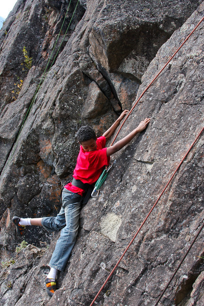 Samuel searches for footholds on <i>Star Light 5.7</i>.