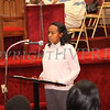 Anna Nixon reads quotes from Abraham Lincoln during the Dr Martin Luther King, Jr. Program at Bethel Missionary Baptist Church in Wappingers Falls, New York on January 18, 2009