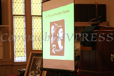 A picture of President Barack Hussein Obama and Dr. Martin Luther King Jr. is displayed during the Dr Martin Luther King, Jr. Program at Bethel Missionary Baptist Church in Wappingers Falls, New York on January 18, 2009