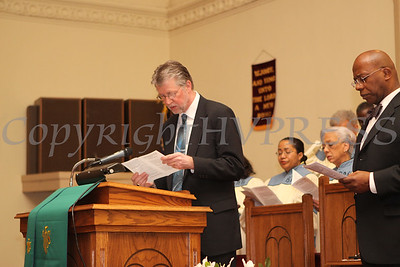 Rev William Dalrymple, pastor of Community Baptist Church (at podium) reads the Litany along with Bethel Missionary Baptist Church Pastor Edward L Hunt during the Dr Martin Luther King, Jr. Program at Bethel Missionary Baptist Church in Wappingers Falls, New York on January 18, 2009