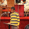 Thomas Nixon reads quotes from President Barack Obama during the Dr Martin Luther King, Jr. Program at Bethel Missionary Baptist Church in Wappingers Falls, New York on January 18, 2009