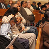A mother holds her two young children during the Dr Martin Luther King, Jr. Program at Bethel Missionary Baptist Church in Wappingers Falls, New York on January 18, 2009