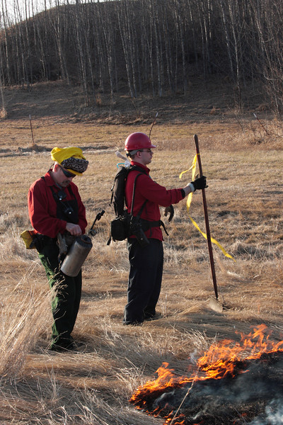 Bowzr Diaz readies his torch while Firing Boss Jake Boothby checks the wind, burning a small test area before we commence the main burns.