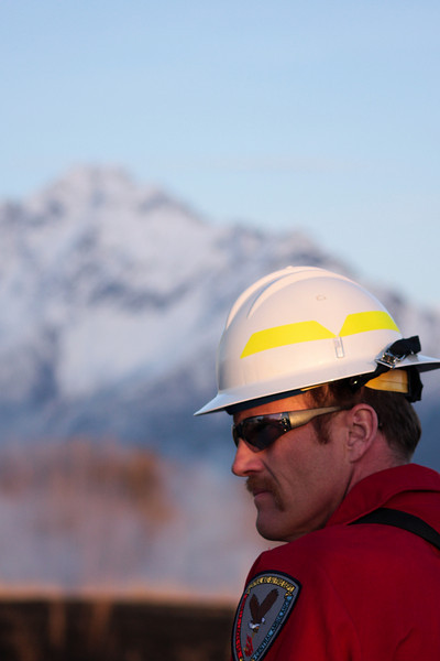 Safety Officer John Darnell oversees the firing operation.