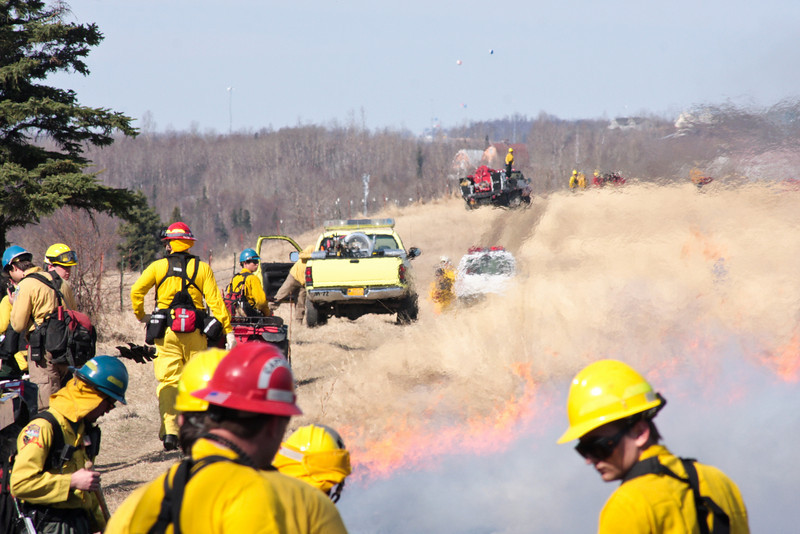 Heat waves distort views of other apparatus beyond the burn.
