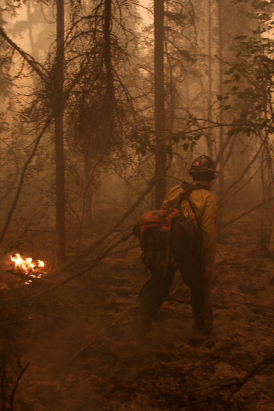 Danny Clemons moves through the smoky woods looking for the edges of this uncontained portion of the fire.