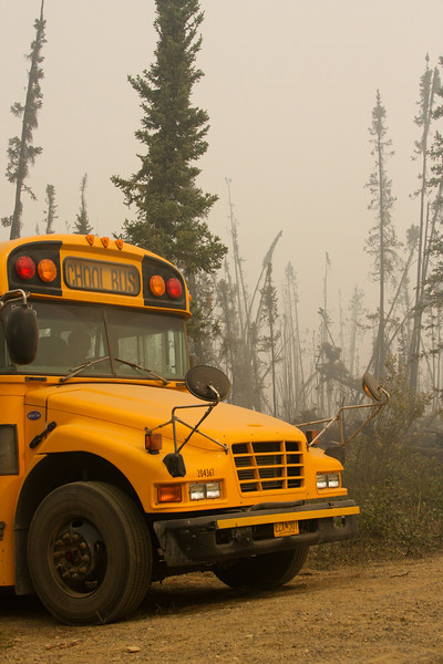 School buses were contracted to haul the many hand crews around the fireground.
