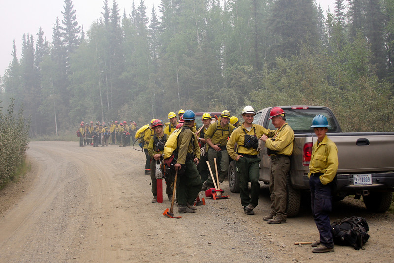 Two crews prepare to move out on the fireline for a day's work.