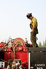 Danny Clemons checks out the workings atop the truck on he first day on the fire.