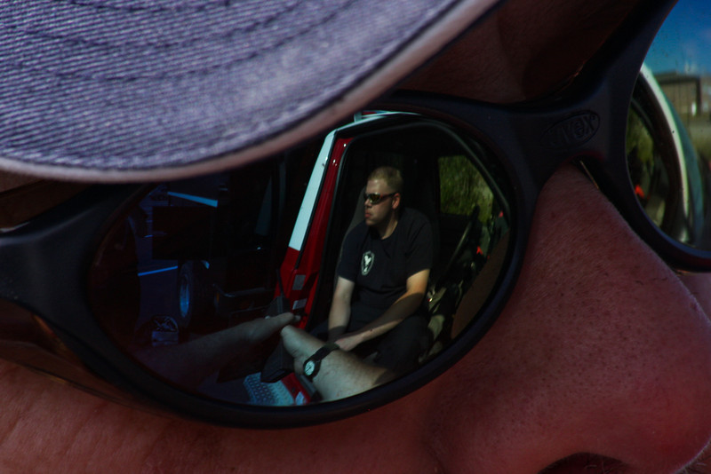 John Atwell reflected in the lenses of Gary's sunglasses, still waiting for word on where we will be going.  It wound up being the next day before we actually hit the road.