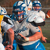 Tribune-Star file photo/Joseph C. Garza<br /> Blocking for the running play: Rockville center James Kent blocks a teammate for a running back during team practice Wednesday, Nov. 4 in Rockville.