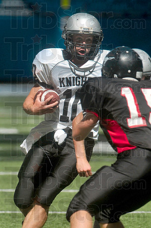 Tribune-Star file photo/Joseph C. Garza<br /> Big yardage: Northview's Trent Lancaster evades the Edgewood defense for a gain in yardage during the Knights' 48-33 win Saturday, Aug. 29 in the Marsh Hoosier Classic in Indianapolis.