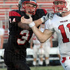 Tribune-Star file photo/Bob Poynter<br /> Gotcha: South's Logan Buske gets to Center Grove quarterback Kyle Barth during first half action Friday, Sept. 18 at South.