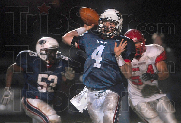 Tribune-Star file photo/Joseph C. Garza<br /> Trying to get something started: Terre Haute North quarterback Chris O'Leary finds teammate Aaron Allen open during the fourth quarter of the Patriots' game against Pike Friday, Oct. 23 at North.