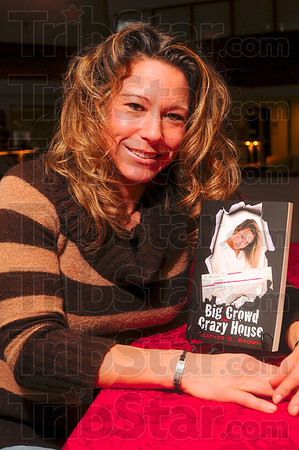Tribune-Star/Joseph C. Garza<br /> Lived to write about it: Author Heather Brown shares her experiences with bipolar disorder in her new book, Big Crowd at the Crazy House. Brown signed copies of the book Saturday at the Vigo County Library.