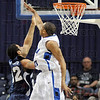 Defense: Indiana State guard Dwayne Lathan causes an Oral Roberts player tom miss at close range during game action Sunday afternoon.