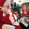 Excited: Sierra Cooper gets excited as she opens a gift from Santa Clause Sunday afternoon in her Clinton, Indiana residence.