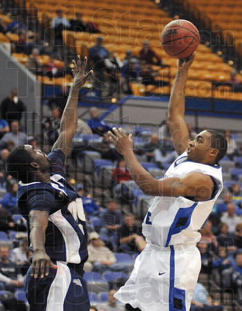 Runner: Indiana State's #23, Harry Marshall takes a runner down the lane during game action against Oral Roberts Sunday afternoon.