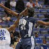 Double facial: Indiana State's #20, Dwayne Lathan attempts a shot that is being blocked by #45, Dominique Morrison of Oral Roberts during Sunday's game. Morrison also got a facial in return for his effort.