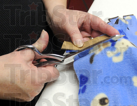 Cutting: Detail photo of blanket production.