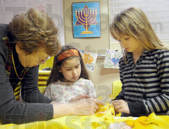 Blankets: Shirley Wormser shows Jennifer Garcia-Israel and Noam Wasik how to make the blankets Sunday afternoon.
