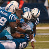 Four all over: Tennessee quarterback Vince Young is tackled by four Indianapolis defenders including Robert Mathis, Clint Session (55), and Dwight Freeney (93) during the Colts' victory Sunday in Indianapolis.