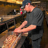 Tribune-Star/Joseph C. Garza<br /> Handmade: Gerhardt's Bierstube kitchen manager Matt Taylor prepares a mixture of bacon, onion and seasoning's for a roll of rouladen Tuesday at the restaurant.