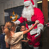 Tribune-Star/Joseph C. Garza<br /> Just one more hug, Santa: Lambda Chi Alpha member and Santa's helper, Ben McNees, a Rose-Hulman sophomore, receives a hug from Chelsey Robbins and Julio Fundora after he passed out presents Saturday at the Rose-Hulman fraternity house.