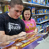 Shoppers: Joe Foley and Laci Delisle shop for children's toys at K-Mart Friday afternoon.