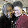 Best buds: Aletha Carter gets a hug from Theressa Bynum after realizing she'd been lured to the MCL Cafeteria Saturday afternoon by Bynum. Several friends and well-wishers enjoyed a lunch to honor Carter.
