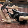 Escape: Northview's Brandon Pleake temporarily escapes the grip of North's Doug Collett during Saturday's event at Northview. Collett eventually pinned Pleake to win the 189 lb. match.