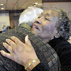 Fond farewell: Greg Ulm gives Aletha Carter a hug and wishes her well in her travels as she arrives at the MCL Cafeteria Saturday afternoon for lunch. Carter was unaware of the gathering to honor her. She was duped into believing she and Theresa Bynum were going to lunch together.