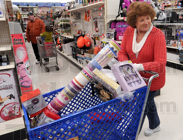 Bargain hunter: Beth Hughes of Terre Haute glides down the isle at K-Mart Friday afternoon looking for a good deal.